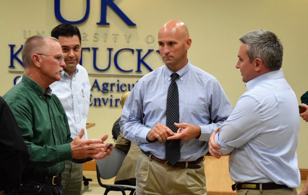 BARREN COUNTY DAIRY FARMER Richard Mattingly, left, speaks with Matt London, Judge / Executive Micheal Hale, and Commissioner of Agriculture Ryan Quarles during an agriculture forum last week at the local University of Kentucky Agriculture Extension Office.