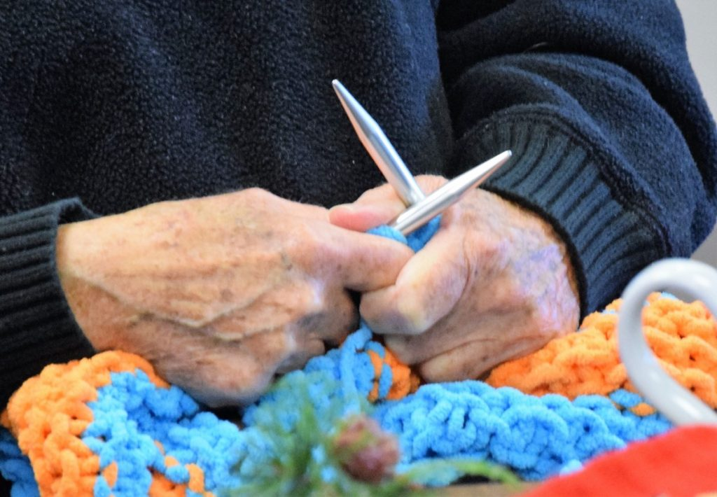 Knitting Ministry hands and needles