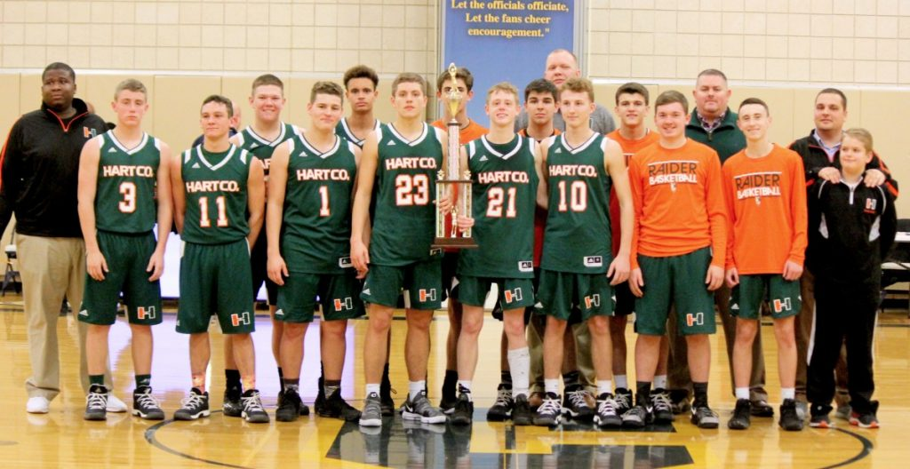 The Hart County Raiders traveled to compete in the Louisville Collegiate Classic December 28-30 where they took home the championship after defeating Portland Christian 89-68, Thomas Nelson 56-52, and Louisville Collegiate 71-64. Above the team poses with the trophy. STANLEY BELL/NEWS-HERALD
