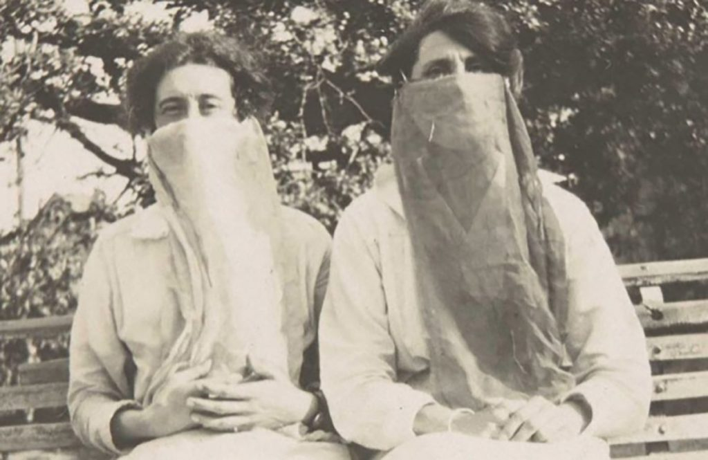 Ladies in masks during the 1918 outbreak of the Spanish Influenza, thought to he the worst pandemic in history.